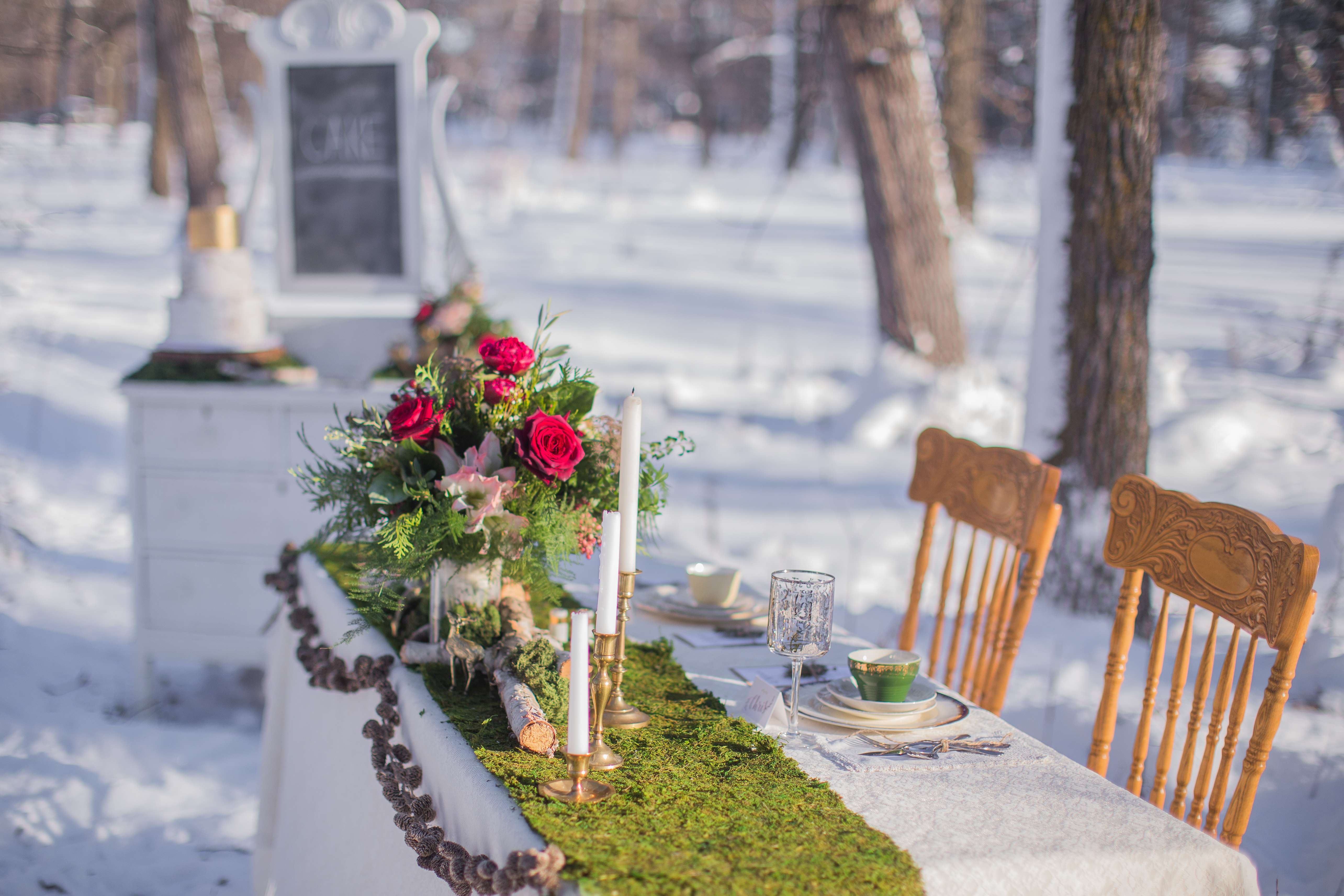 Winter wedding sweetheart table and vintage dresser cake stand