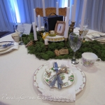Moss covered wedding table with vintage mis matched china dishes