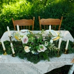 Outdoor sweetheart table at La Lune Weddings & Events
