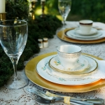 Vintage mis matched china sweetheart table at La Lune Weddings & Events