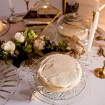 Vintage brass candle holders and glass cake stands at Gimli Park Pavilion